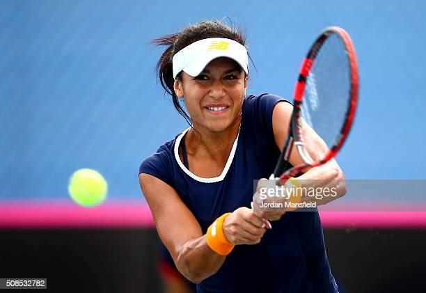 Heather Watson of Great Britain plays a backhand in her match against Sofia Shapatava of Georgia during the tie between Georgia and Great Britain on...