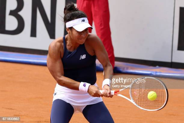 Heather Watson of Great Britain plays a backhand in her singles match against IrinaCamelia Begu of Romania during day 2 of the Fed Cup World Group II...