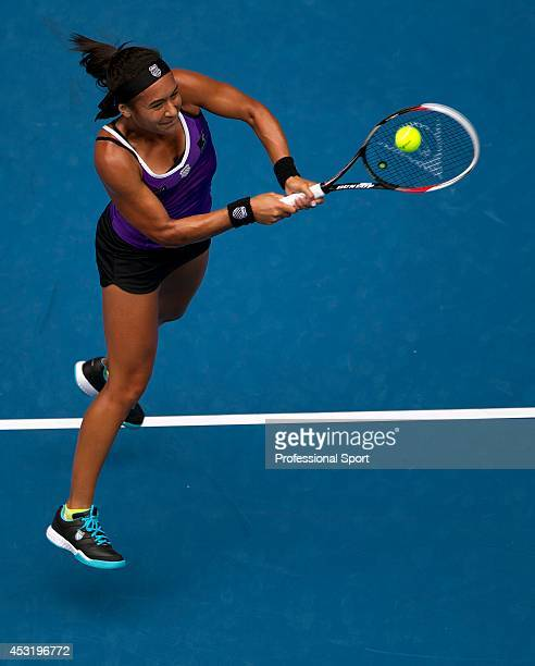 Heather Watson of Great Britain plays a backhand in her third round match against Agnieszka Radwanska of Poland during day five of the 2013...