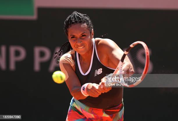 Heather Watson of Great Britain plays a backhand in their ladies singles first round match against Zarina Diyas of Kazakhstan on day two of the 2021...