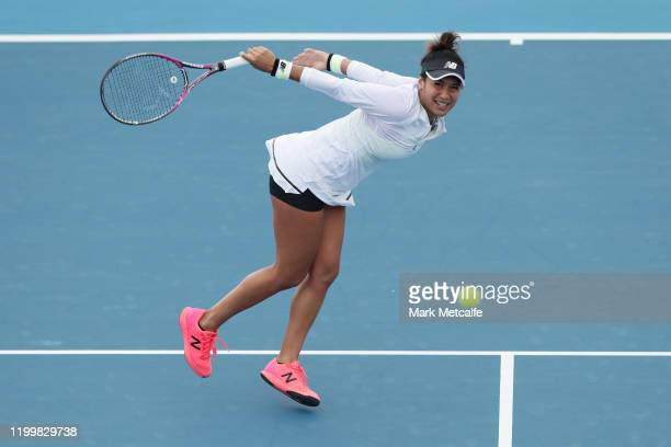 Heather Watson of Great Britain plays a backhand volley during her quarter final singles match against Elise Mertens of Belgium during day six of the...