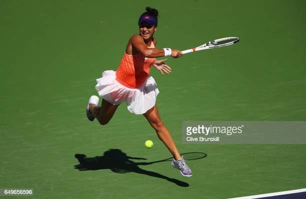 Heather Watson of Great Britain plays a forehand against Nicole Gibbs of the United States in their first round match during day three of the BNP...