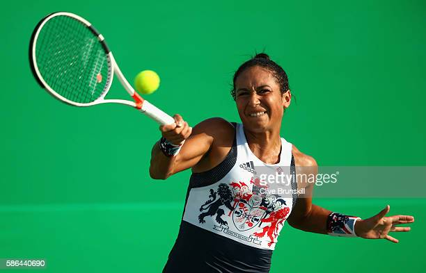Heather Watson of Great Britain plays a forehand against Shuai Peng of China in their first round match on Day 1 of the Rio 2016 Olympic Games at the...