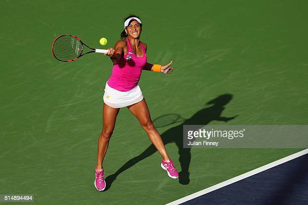 Heather Watson of Great Britain plays a forehand in her match against Monica Niculescu of Romania during day five of the BNP Paribas Open at Indian...