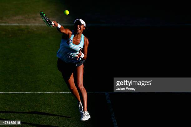 Heather Watson of Great Britain plays a smash to Elina Svitolina of Ukraine during the Aegon International day three at Devonshire Park on June 23...
