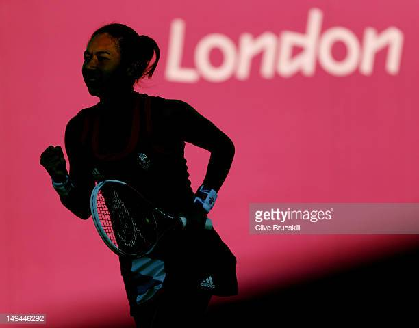Heather Watson of Great Britain plays against Sabine Lisicki and Angelique Kerber of Germany during her Women's Doubles Tennis match on Day 1 of the...