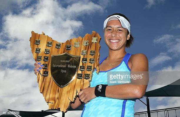 Heather Watson of Great Britain poses with the winners trophy after victory in her singles final match against Madison Brengle of the USA during day...