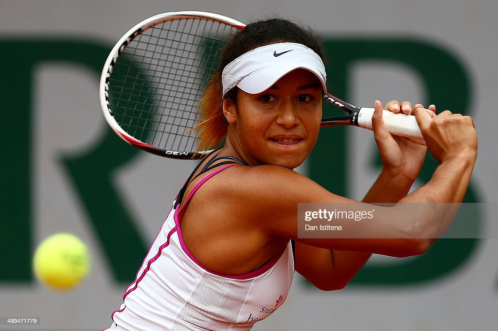 Heather Watson of Great Britain returns a shot in her women's singles qualifying match against Anett Kontaveit of Estonia during previews ahead of the French Open at Roland Garros on May 24, 2014 in Paris, France.