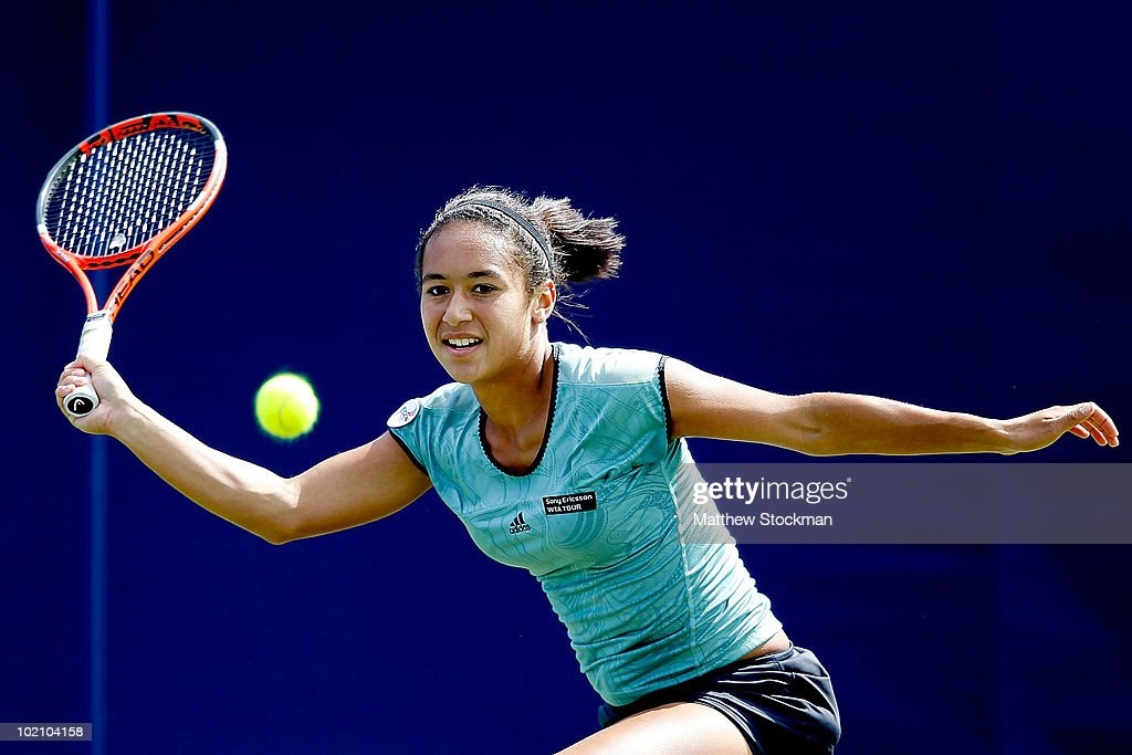 Heather Watson of Great Britain returns a shot to Aleksandra Wozniak of Canada during the AEGON International at Devonshire Park on June 15, 2010 in Eastbourne, England.