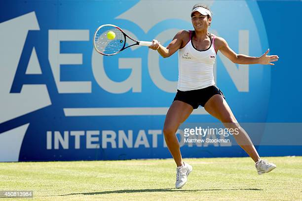 Heather Watson of Great Britain returns a shot to Flavia Pennetta of Italy during the Aegon International at Devonshire Park on June 18 2014 in...