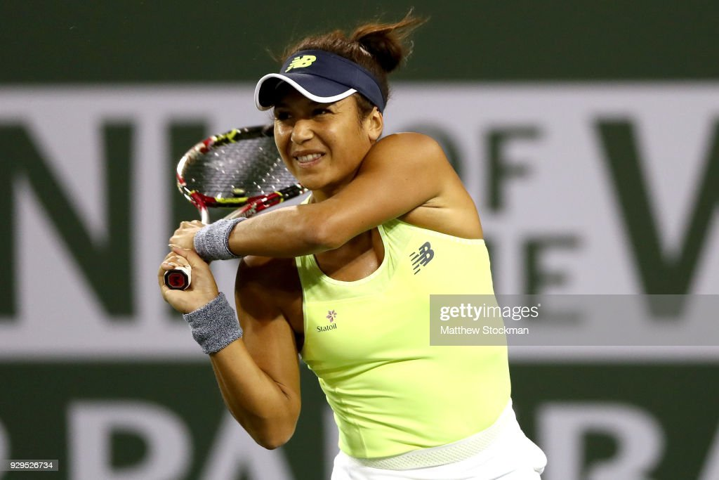 Heather Watson of Great Britain returns a shot to Victoria Azarenka of Belarus during the BNP Paribas Open at the Indian Wells Tennis Garden on March 8, 2018 in Indian Wells, California.