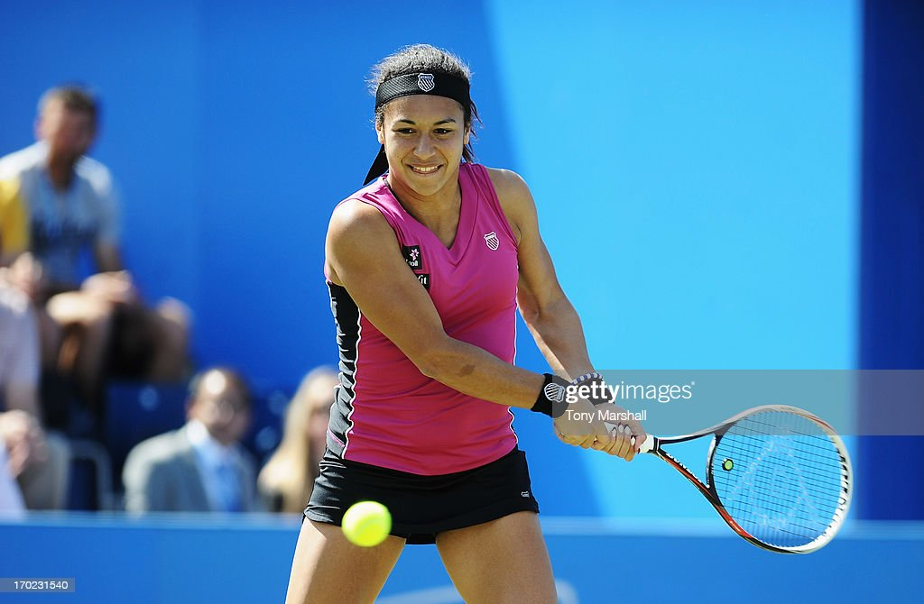 Heather Watson of Great Britain returns in her mixed doubles exhibition match partnering Tim Henman against Greg Rusedski and Sorana Cirstea of Romania during day one of the AEGON Classic tennis tournament at Edgbaston Priory Club on June 9, 2013 in Birmingham, England.