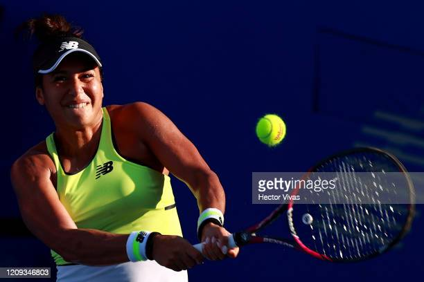 Heather Watson of Great Britain returns the ball during the singles match between Heather Watson of Great Britain and Xiyu Wang of China as part of...
