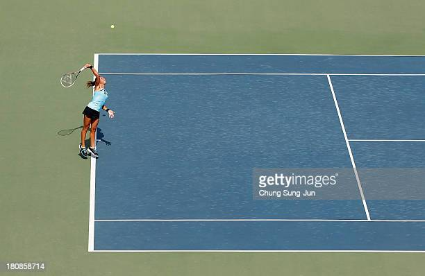 Heather Watson of Great Britain serves against Kimiko DateKrumm of Japan during day two of the KDB Korea Open 2013 at Seoul Olympic Park Tennis...