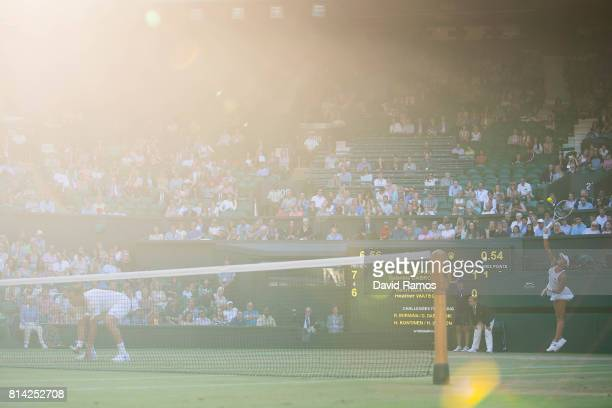Heather Watson of Great Britain serves during the Mixed Doubles quarter final match against Rohan Bopanna of India and Gabriela Dabrowski of Canada...