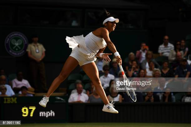 Heather Watson of Great Britain serves partnering Henri Kontinen of Finland in the Mixed Doubles quarter final match against Rohan Bopanna of India...