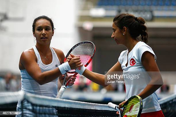 Heather Watson of Great Britain shakes hands with Cagla Buyukakcay of Turkey during day two of the Fed Cup/Africa Group One tennis at Syma Event and...