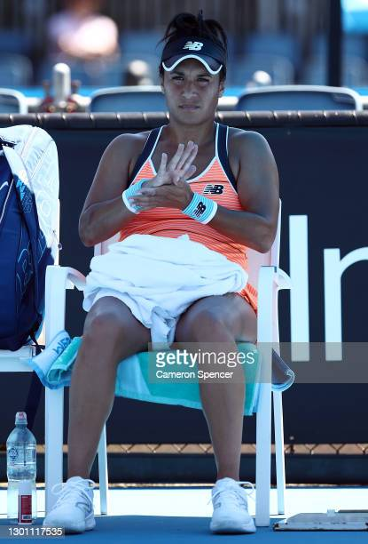 Heather Watson of Great Britain sits down in between games in her Women's Singles first round match against Kristyna Pliskova of Czech Republic...