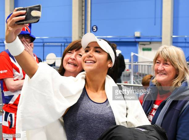 Heather Watson of Great Britain takes a photo with fans following her victory during the Fed Cup Europe/Africa Group 1 Pool C Singles match against...