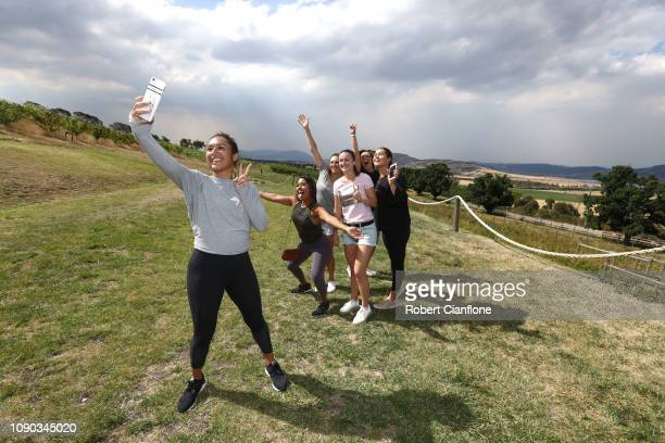 Heather Watson of Great Britain takes a selfie with Sabrina Santamaria Dalila Jakupovic Ellen Perez Isabelle Wallace and Desiree Krawcyk during a...