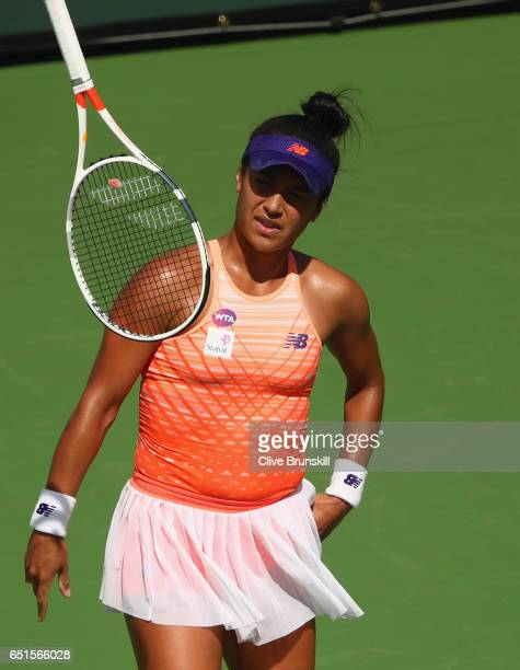 Heather Watson of Great Britain throws her racket against Johanna Konta of Great Britain in their second round match during day five of the BNP...