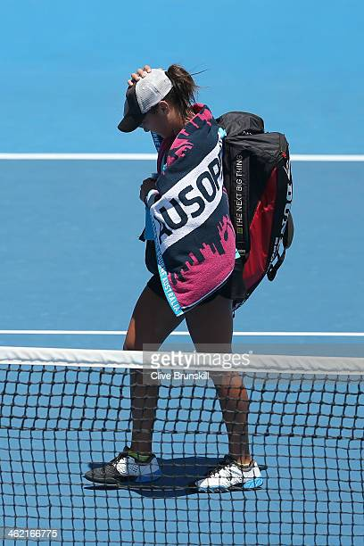 Heather Watson of Great Britain walks off after losing her first round match against Daniela Hantuchova of Slovakia during day one of the 2014...