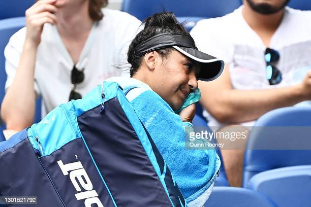 Heather Watson of Great Britain wipes her face after losing her Women's Singles second round match against Anett Kontaveit of Estonia during day four...
