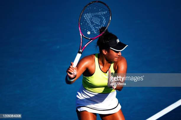 Heather Watson of United Kingdom returns a ball during the singles match between Xiyu Wang of China and Heather Watson of United Kingdom as part of...
