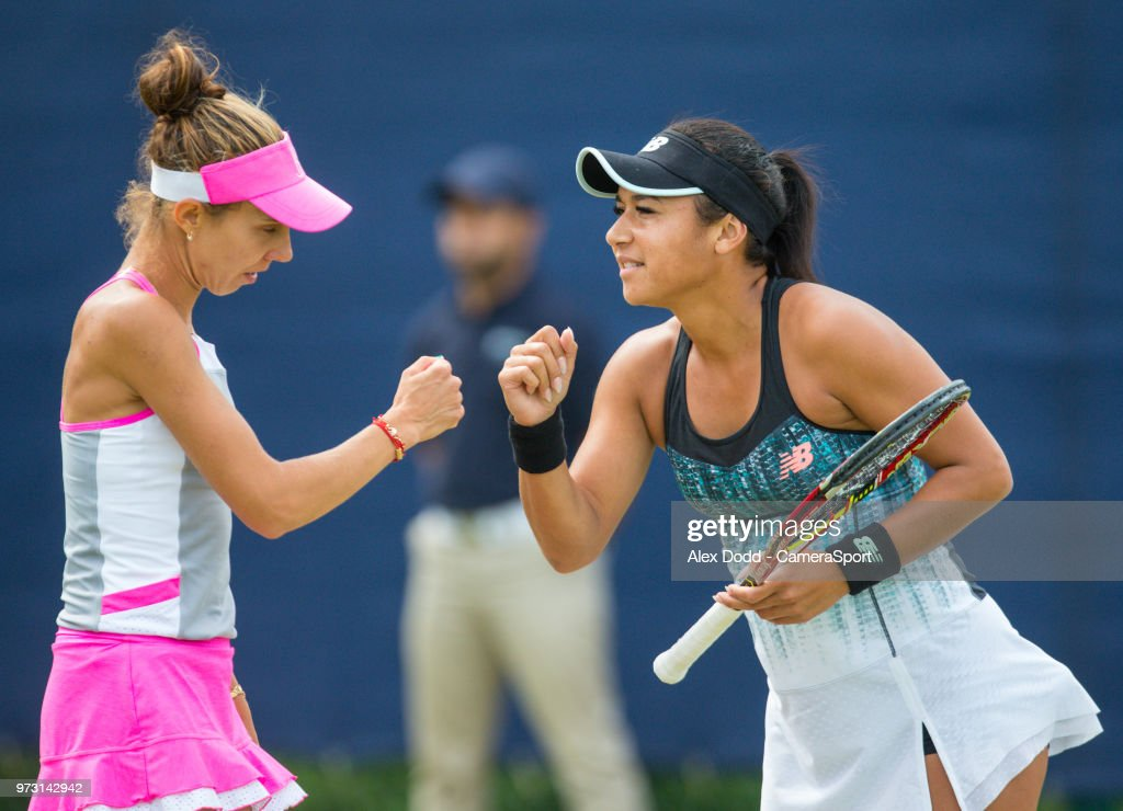 Heather Watson shares a word with her partner Mihaela Buzarnescu during day 3 of the Nature Valley Open Tennis Tournament at Nottingham Tennis Centre on June 13, 2018 in Nottingham, England.