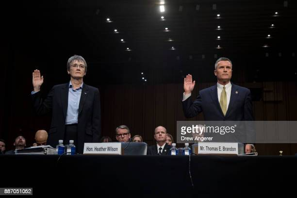 Heather Wilson Secretary of the US Air Force and Thomas Brandon acting director of the Bureau of Alcohol Tobacco Firearms and Explosives are sworn in...