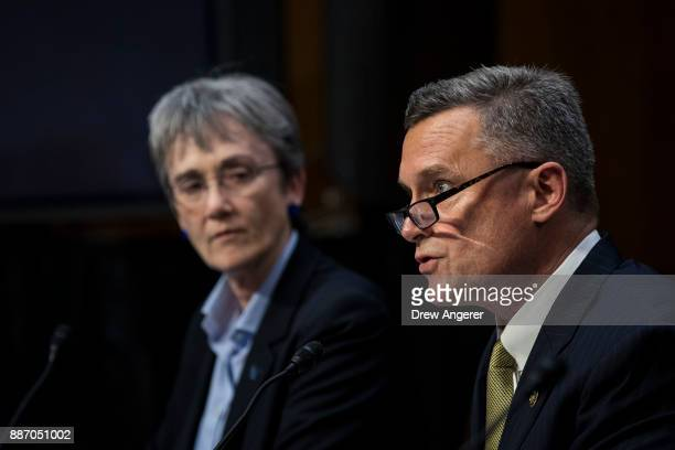 Heather Wilson Secretary of the US Air Force looks on as Thomas Brandon acting director of the Bureau of Alcohol Tobacco Firearms and Explosives...