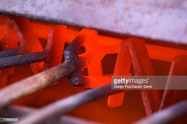 heating cattle branding irons - livestock branding stock photos and pictures