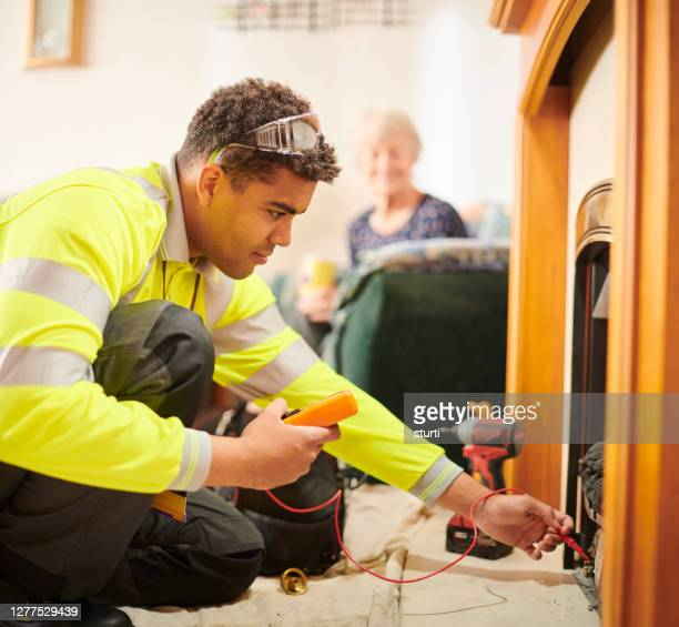 heating engineer - repairing stock pictures, royalty-free photos & images