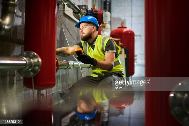 heating exchange inspection - pipe stock pictures, royalty-free photos & images