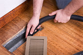 Heating Vent Air Duct Getting Cleaned