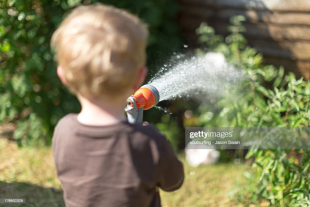 Heatwave - Watering the Garden : Stock Photo