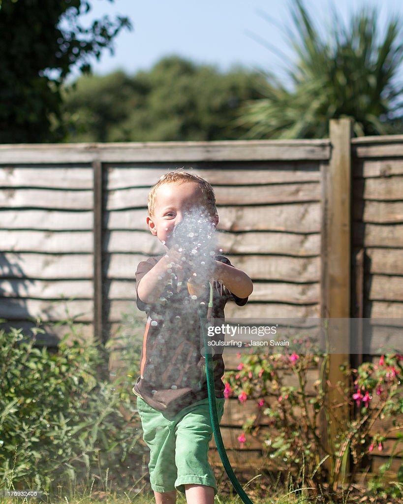 Heatwave - Watering the Garden : Foto de stock