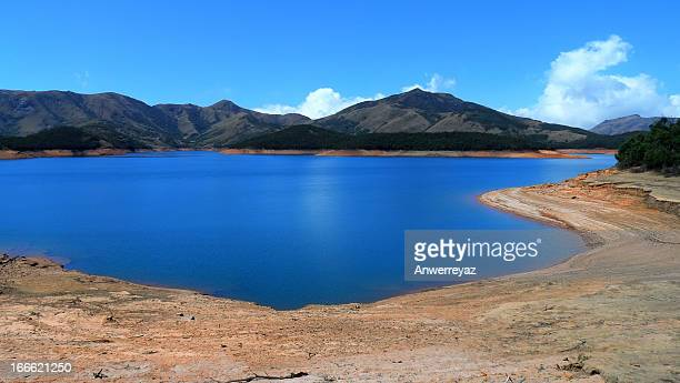 Heaven - Blue Lake at the foothills on a blue sky