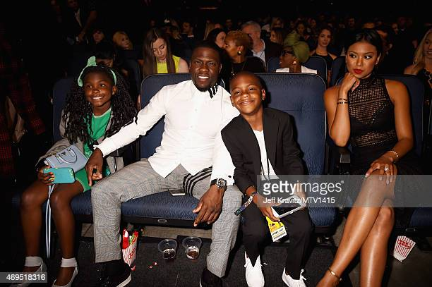 Heaven Hart actor Kevin Hart Hendrix Hart and Eniko Parrish attend The 2015 MTV Movie Awards at Nokia Theatre LA Live on April 12 2015 in Los Angeles...