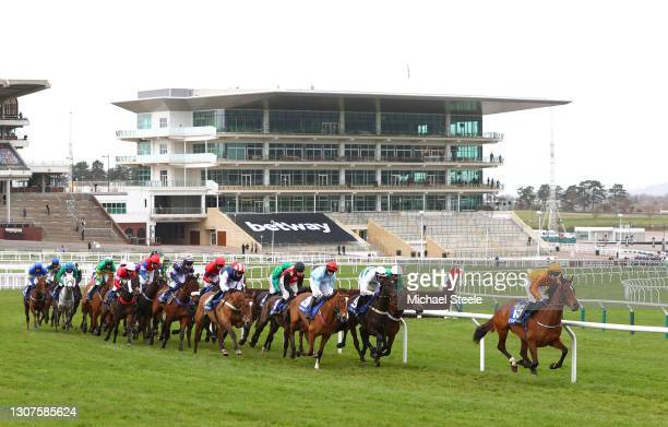 Heaven Help Us ridden by Richard Condon leads the field past empty stands during the the Coral Cup Handicap Hurdle race on Day Two of the Cheltenham...