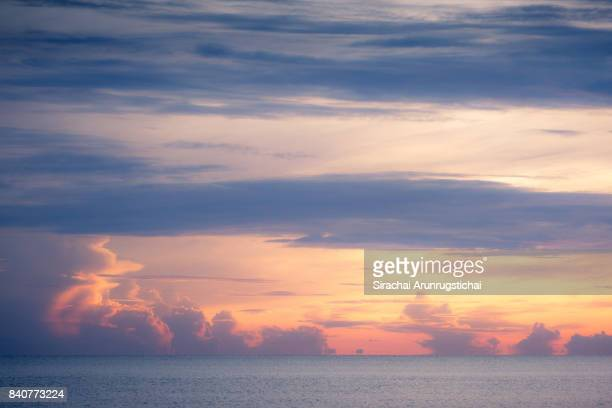 heavenly scenery of morning sky over calm sea - seascape stock pictures, royalty-free photos & images