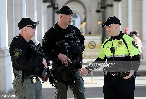 Heavily armed Amtrak police patrol near the front entrance of Union Station November 25 2015 in Washington DC With the recent terror attacks in Paris...