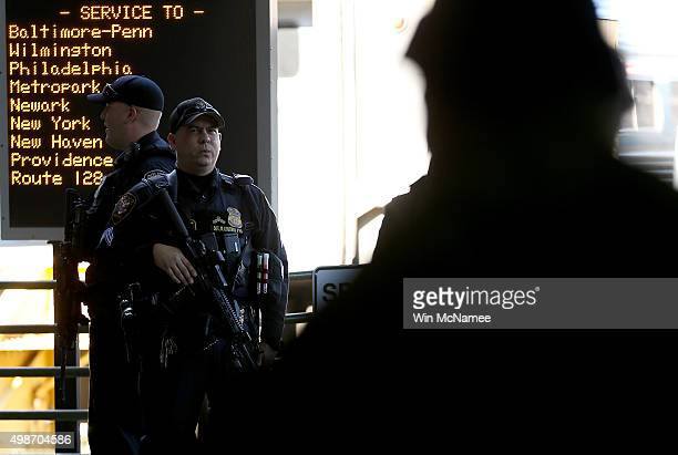 Heavily armed Amtrak police patrol the train platform at Union Station November 25 2015 in Washington DC With the recent terror attacks in Paris...