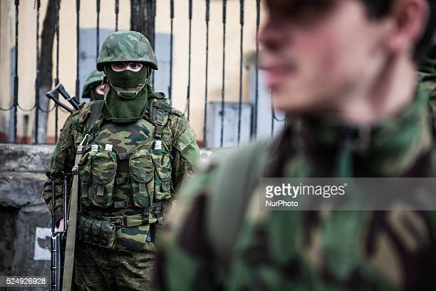 Heavily armed anonymous soldiers standing guard at the Coast Guard Headquarter on Karl Marx Street in Simferopol Crimea on March 5th 2014