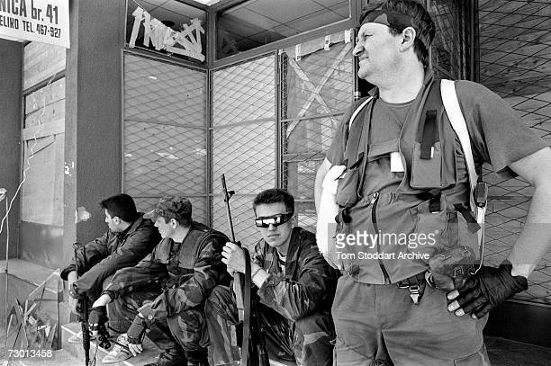 Heavily armed Bosnian fighters rest during a break in the hostilities near Sarajevo's frontline During the 47 months between the spring of 1992 and...
