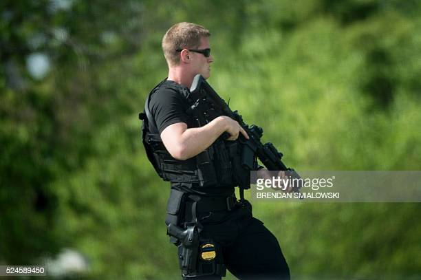 A heavily armed member of the Secret Service patrols the North Lawn of the White House during a security lockdown April 26 2016 in Washington DC /...