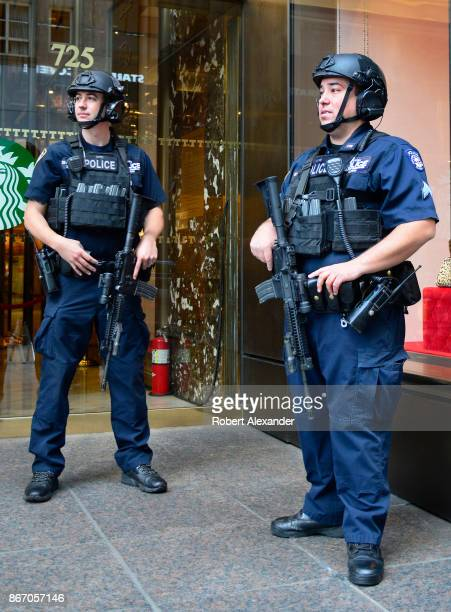 Heavily armed members of the New York City Police Department's Counterterrorism Bureau stand guard in front of Trump Tower in New York New York