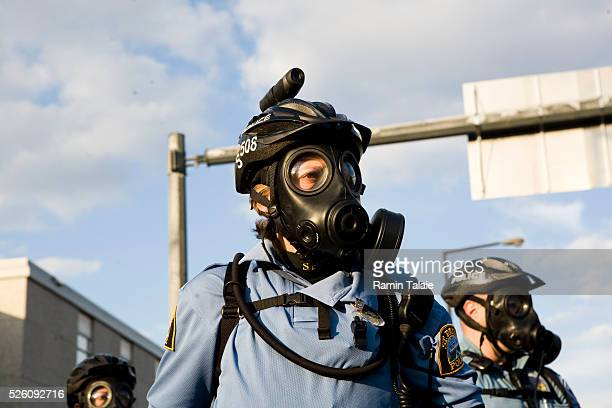 A heavily armed Minneapolis police officer with a camera on his helmet during a demonstration near the Xcel Center at the Republican National...