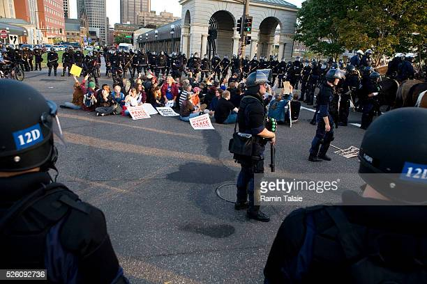 Heavily armed Minneapolis police officers circle a group of a demonstrators near the Xcel Center at the Republican National Convention in St Paul...