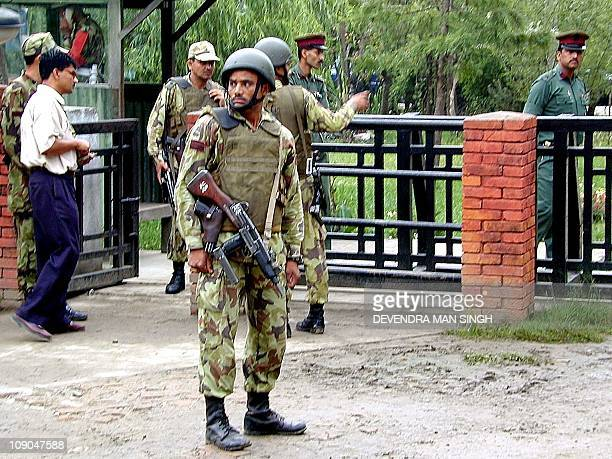Heavily armed Nepalese army soldiers guard the Army Hospital gate amidst tightened security in Kathmandu 02 June 2001 following the fatal shooting of...